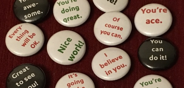 """A number of button badges with phrases on them like """"Of course you can"""", """"You're ace"""" and """"You can do it!"""""""